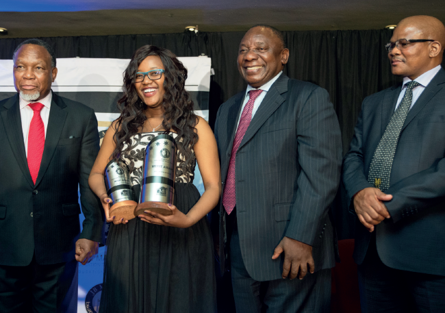 Kgalema Motlanthe, Cyril Ramaphosa and David Sipunzi with top-performing JB Marks student, Malentsoe Getrude Mosito